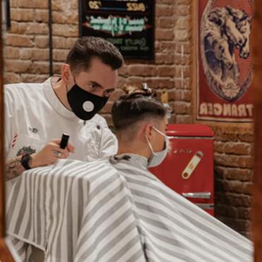 Barber shaving a man's head